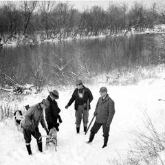 Ray Roark, Aldo Leopold, Luna, and George Bryan hunting at the Ozark Cabin