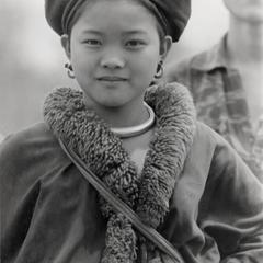 A Yao (Iu Mien) girl in traditional clothing and silver adornments in Houa Khong Province