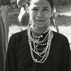 Nyaheun woman displays her traditional Nyaheun necklace in Attapu Province