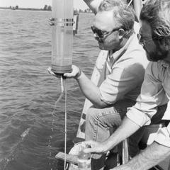 Professors Bud Harris and James Wiersma taking water samples