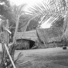 The Rear of Poorer Houses with Cassava Roots Drying on the Roof