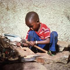 Boy Playing with Father's Woodcarving Tools