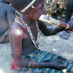 Boy Eating Sugar Cane While on Break from Mbondo Initiation Ceremony
