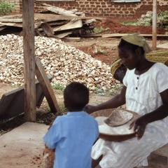 Woman and child collecting gari