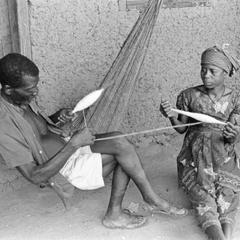 Man and Woman Spinning Cotton