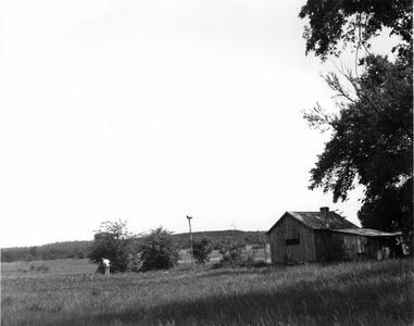 Aldo Leopold in shack prairie