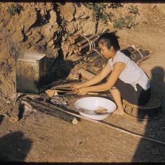 Girl cooking on tank