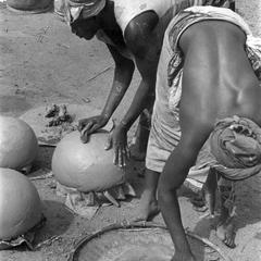Women Forming Rounded Pots