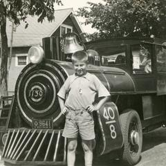 """Fred Keip Jr. with """"40 et 8"""" locomotive"""