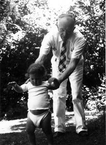 Aldo Leopold helping grandson Bruce to walk