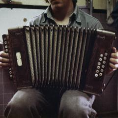 Matthew Gallmann holds Matti Pelto's button accordion