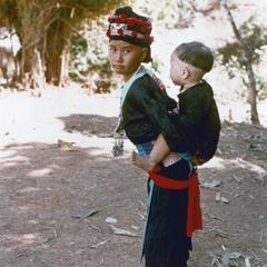 Hmong girl carrying her little brother on her back in Houa Khong Province