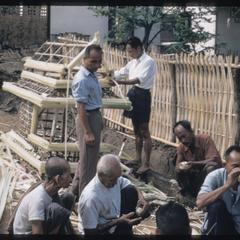 Funeral : men building bamboo palanquin