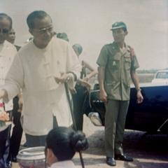 Prince Souvanna Phouma is greeted by local officials at the Luang Prabang airport