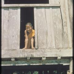 Young bonze at window