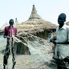Orphan Boys Repairing Net
