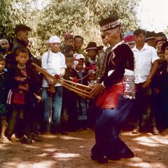 "Hmong man playing Hmong ""qeej"" for Hmong New Year in Houa Khong Province"