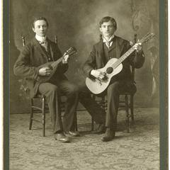 Two men with string instruments