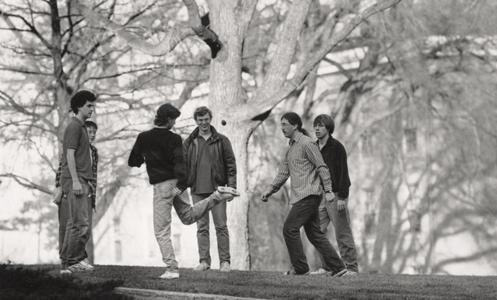 Students playing hacky sack on Bascom Hill