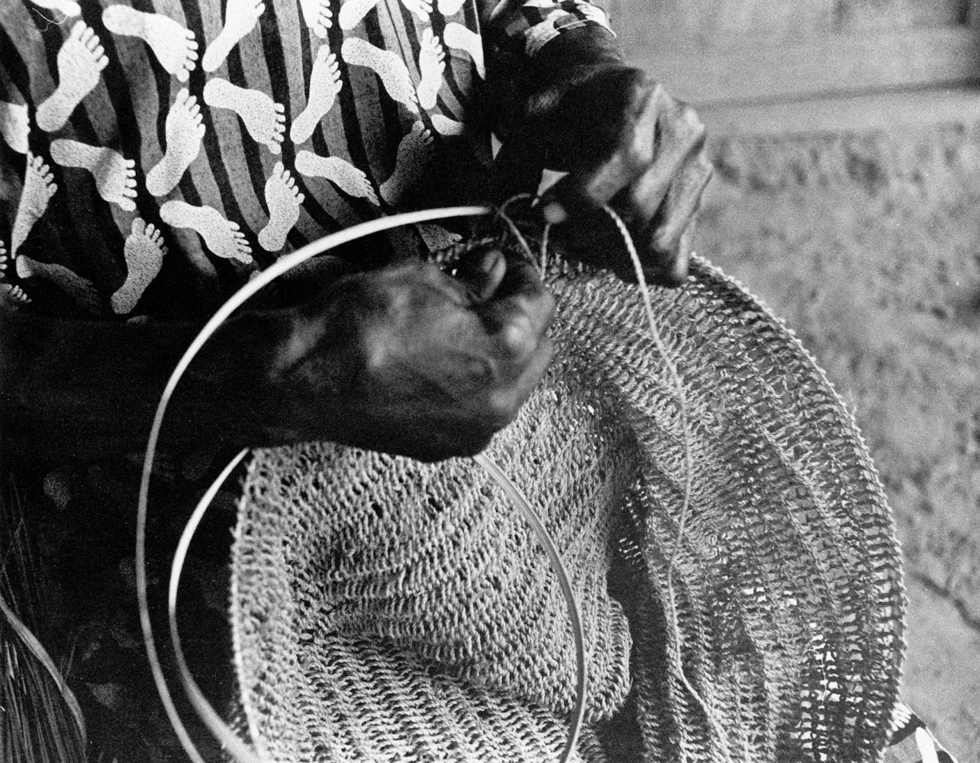 Woman Making Fish Net
