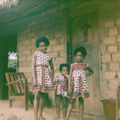Girls in Front of House in Selenge Fishing Village with Modern-Style House, Furniture, and Clothing