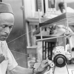 Tailor Putting Thread on Spool for His Machine