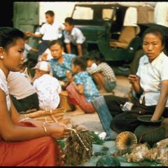 Kammu (Khmu') women--selling cicadas