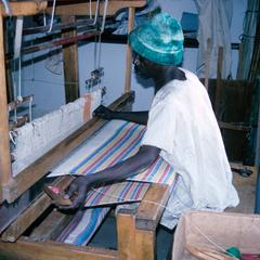 Man Weaving at Loom