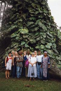 Group posing in front of tree
