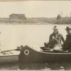 Canoeing in Quetico, cabin in background, June 1924