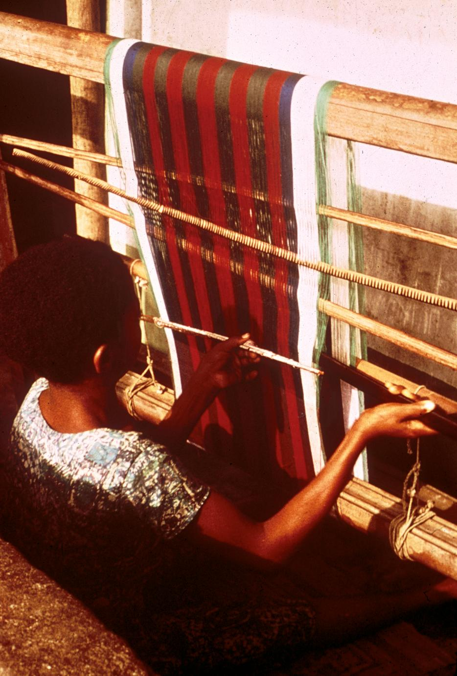 Young Igbo Weaver Working on a Horizontal Loom