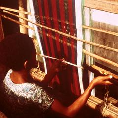 Young Igbo Weaver Working on a Horizontal Loom