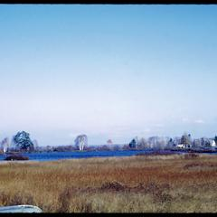 View of wetland, cottages and woods near southern shore of Lake Superior, Cornucopia