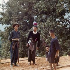 Blue Hmong (Hmong Njua) men planning construction of new home in northern Thailand