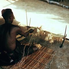 Man Weaving Raffia Mat in Kasai Province