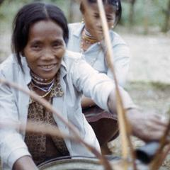 Two Nyaheun women drink rice wine in a village in Attapu Province