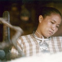 White Lahu (Lahu Hpu) woman spinning in the village of Chalopha in Houa Khong Province