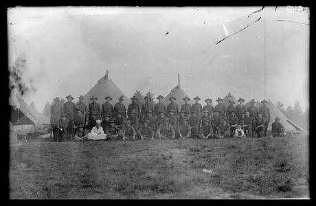 Soldiers in front of military tents