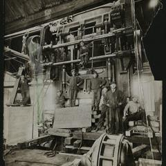 Nash factory employees in front of a Bliss Press