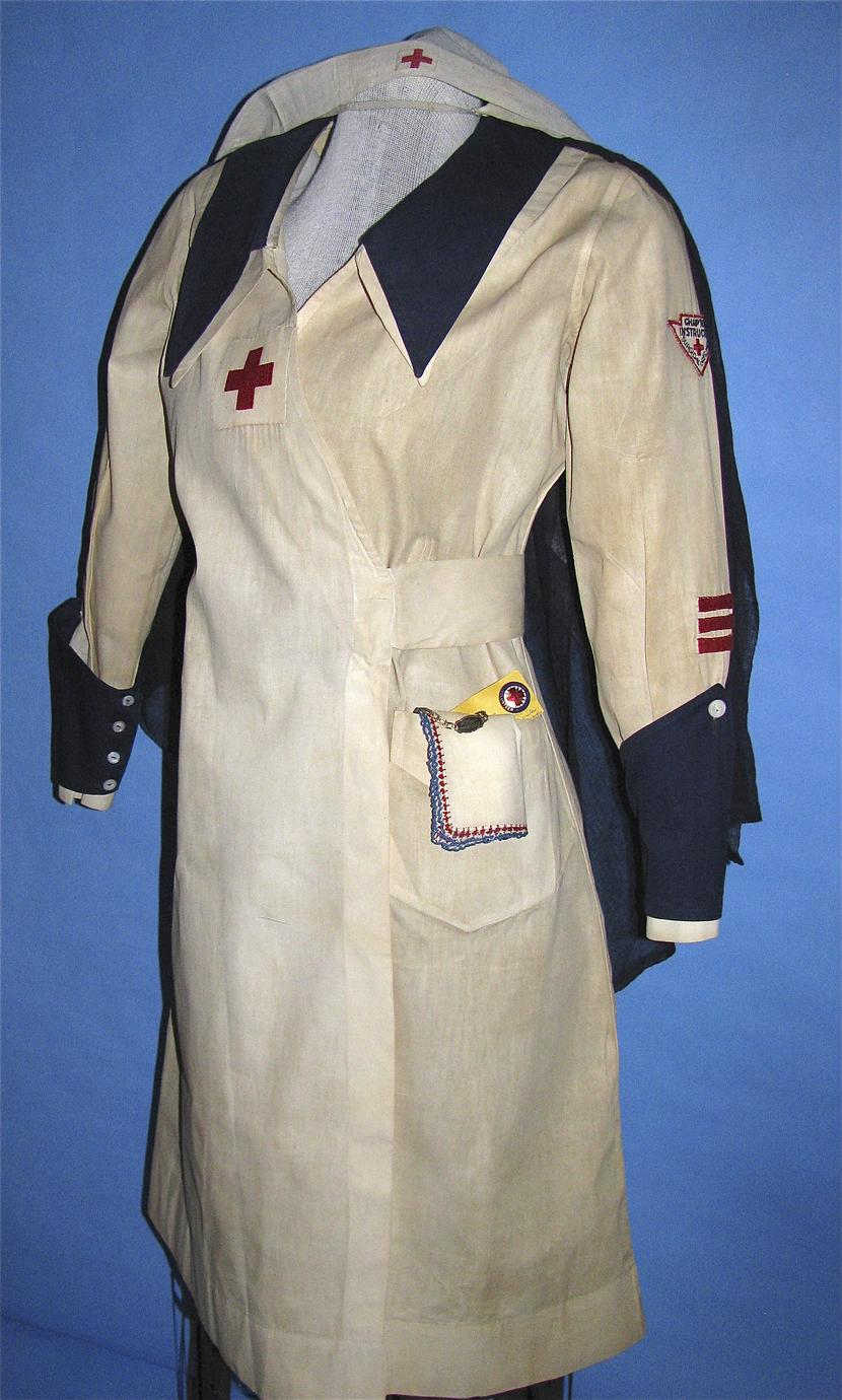Red Cross uniform with I.D. bracelet and pin (1 of 4)