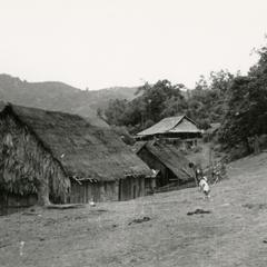 Hmong village with house and rice storage shed on hillside in the vicinity of Muang Vang Vieng in Vientiane Province