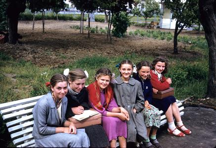 Schoolgirls on a bench