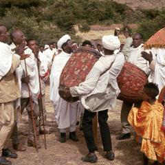 Followers Carrying Drums and Leaning Sticks