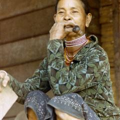 A Nyaheun woman smokes tobacco in her pipe in Attapu Province