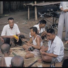 Men making cloth flowers