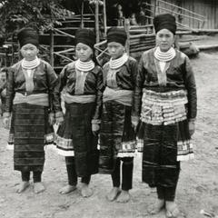 Four Blue Hmong (Hmong Njua) women pose in a Hmong village in the vicinity of Muang Vang Vieng in Vientiane Province