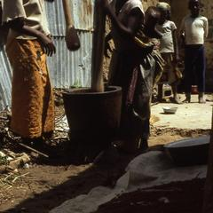 Village women pounding food