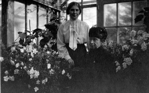 Edith and Clara Leopold in greenhouse