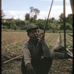 Tai Dam village : farmer with gun
