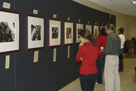 Faculty and students view exhibit